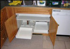 How to install roll out drawers in kitchen cabinets for Adding drawers to existing kitchen cabinets