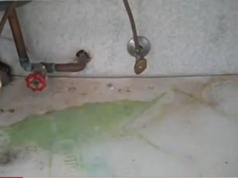 water damaged sink cabinet