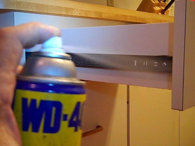 WD-40 Spraying on Cabinet Drawer Slides