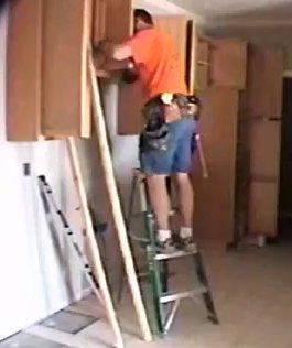 Ladder Installing Cabinets